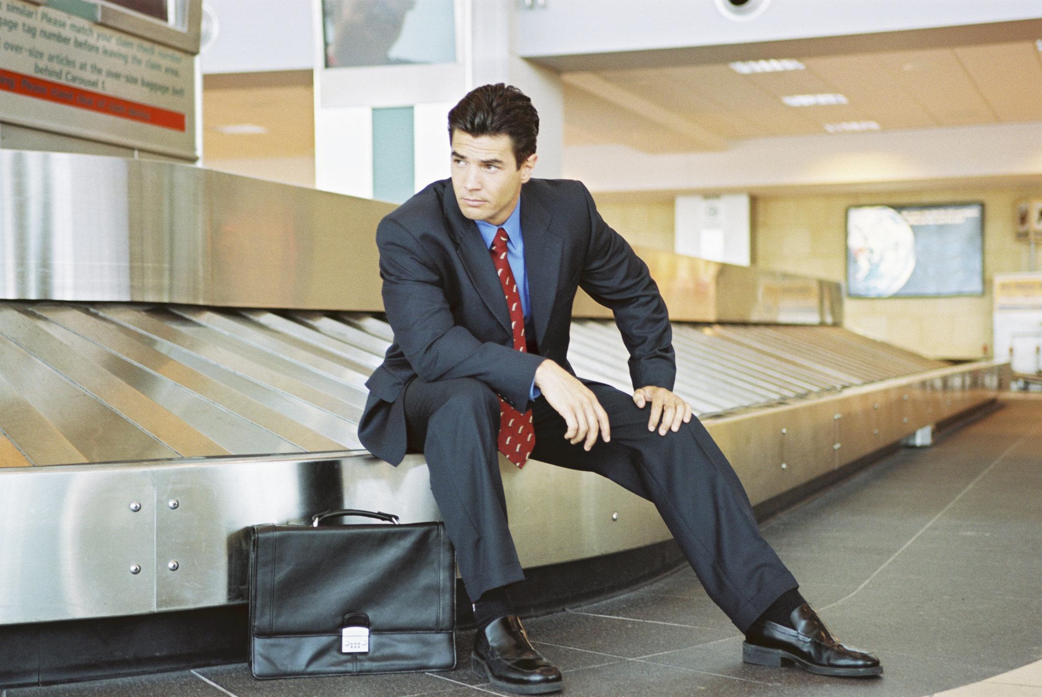 Businessman at baggage claim