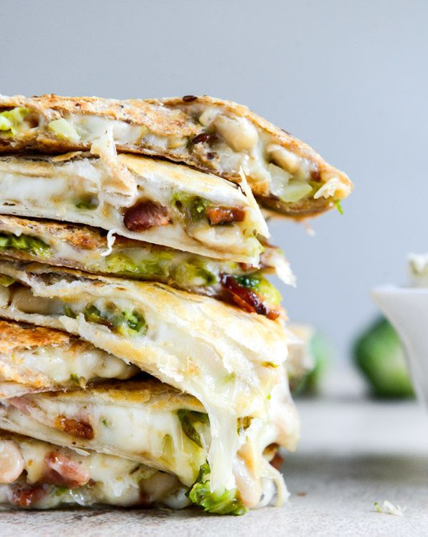 """<strong>Get the <a href=""""http://www.howsweeteats.com/2013/10/brussels-bacon-bean-quesadillas-with-homemade-blue-cheese-dip/"""""""