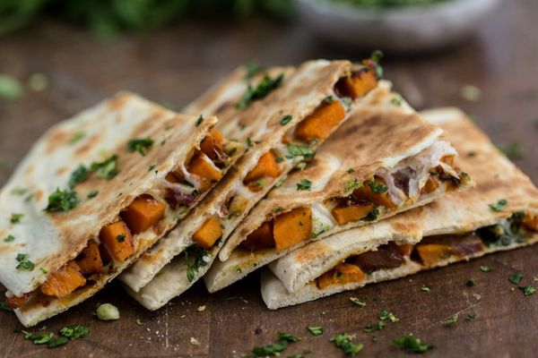 "<strong>Get the <a href=""http://naturallyella.com/2015/01/13/chipotle-sweet-potato-quesadilla-with-cilantro-gremolata/"" targe"