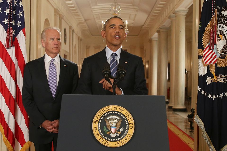 President Barack Obama, standing with Vice President Joe Biden, delivers remarks in the East Room of the White House in Washi