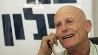 Israeli parliament member Ami Ayalon, one of the leading candidates to head Israel's Labor Party primary elections to take place Tuesday, speaks on the phone in Tel Aviv, Israel, Monday, June 11, 2007. Ayalon is in a run-off with former Israeli Prime Minister Ehud Barak for the leadership of the party Tuesday. (AP Photo/Ariel Schalit)