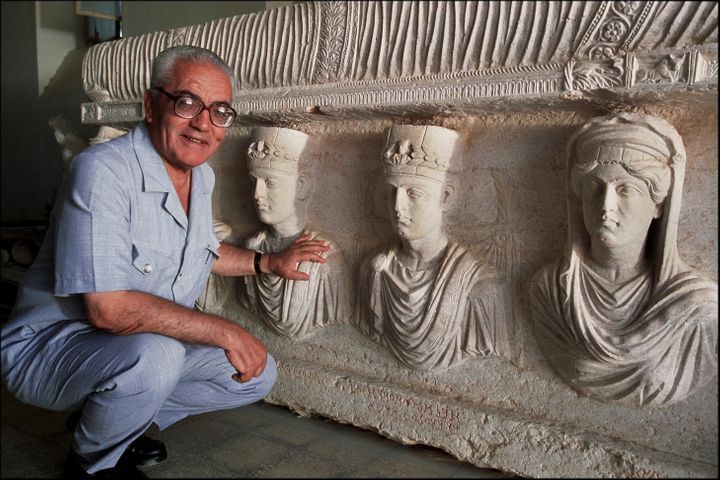 Khaled al-Asaad, the Director of Antiquities and Museum in Palmyra, Syria, in front of a rare sarcophagus, Sept. 1, 2002.&nbs