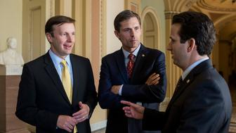 UNITED STATES - JUNE 24: From left, Sen. Chris Murphy, D-Conn., Sen. Martin Heinrich, D-N.M., and Sen. Brian Schatz, D-Hawaii, speak with CQ in the Ohio Clock Corridor in the Capitol on Wednesday, June 24, 2015. (Photo By Bill Clark/CQ Roll Call)