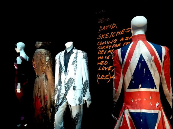 "Alexander McQueen's Union Jack coat creation for Bowie (right). The coat was worn on the cover of Bowie's 1997 ""Earthlings"" a"