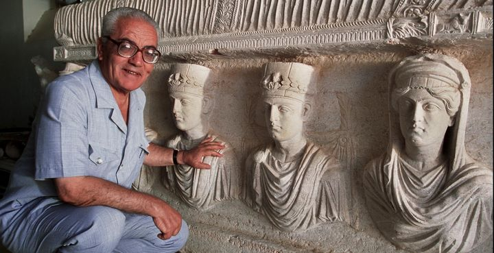 Khaled Asaad poses in front of a rare, 1st-century sarcophagus in Palmyra. Asaad was killed this week by ISIS.