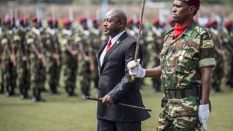Burundi President Pierre Nkurunziza (C) reviews troops after arriving for the celebrations marking the 53rd anniversary of the country's Independence at the Prince Rwagasore stadium in Bujumbura on July 1, 2015. AFP PHOTO/MARCO LONGARI        (Photo credit should read MARCO LONGARI/AFP/Getty Images)