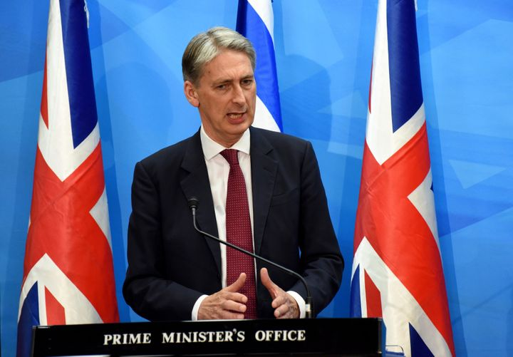 British Foreign Secretary Philip Hammond speaks in favor of the Iran nuclear deal at a press conference at the Israeli prime