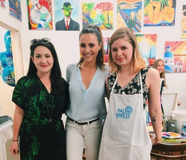 """<span>""""Here To Make Friends"""" co-hosts Emma Gray (L) and Claire Fallon (R), hang out and paint with Andi Dorfman.&nbsp;</span>"""