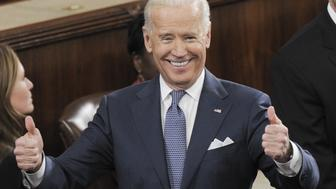 US Vice President Joe Biden gives two thumbs-up prior to US President Barack Obama delivering the State of the Union address before a joint session of Congress on January 28, 2014 at the US Capitol in Washington.  AFP PHOTO/Saul LOEB        (Photo credit should read SAUL LOEB/AFP/Getty Images)