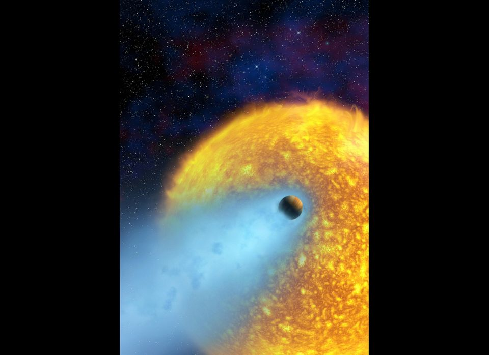 Artist's conception released by NASA of extrasolar planet HD 209458 b, also known as Osiris, orbiting its star in the constel