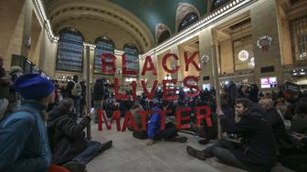 <p>Black Lives Matter protesters gather inside Grand Central Terminal in Manhattan on Dec. 7, 2014.</p>