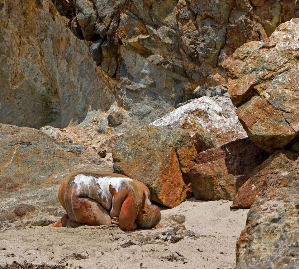 Painted into a rock wall using body paints and raw pigments at Point Dume-Zuma Beach, CA.