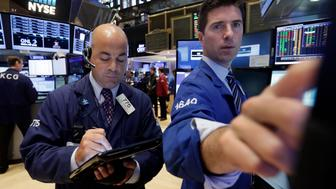 Trader Fred DeMarco, left, works on the floor of the New York Stock Exchange, Thursday, Aug. 20, 2015. The U.S. stock market is opening sharply lower following a renewed drop in Chinese shares. (AP Photo/Richard Drew)