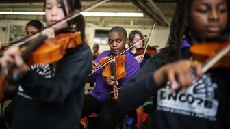 NEW ORLEANS, LA - MAY 13:  Students attend music class at the Encore Academy charter school on May 13, 2015 in New Orleans, Louisiana. More than 100 schools in the city were damaged or destroyed by Hurricane Katrina. Following Katrina, New Orleans' decimated public school system was almost entirely revamped and now approximately 94 percent of city students attend independently run charter schools. Encore Academy's performing arts focused program is outpacing most other open admission charter schools in academic performance in the city. The tenth anniversary of Hurricane Katrina, which killed at least 1836 and is considered the costliest natural disaster in U.S. history, is August 29.  (Photo by Mario Tama/Getty Images)