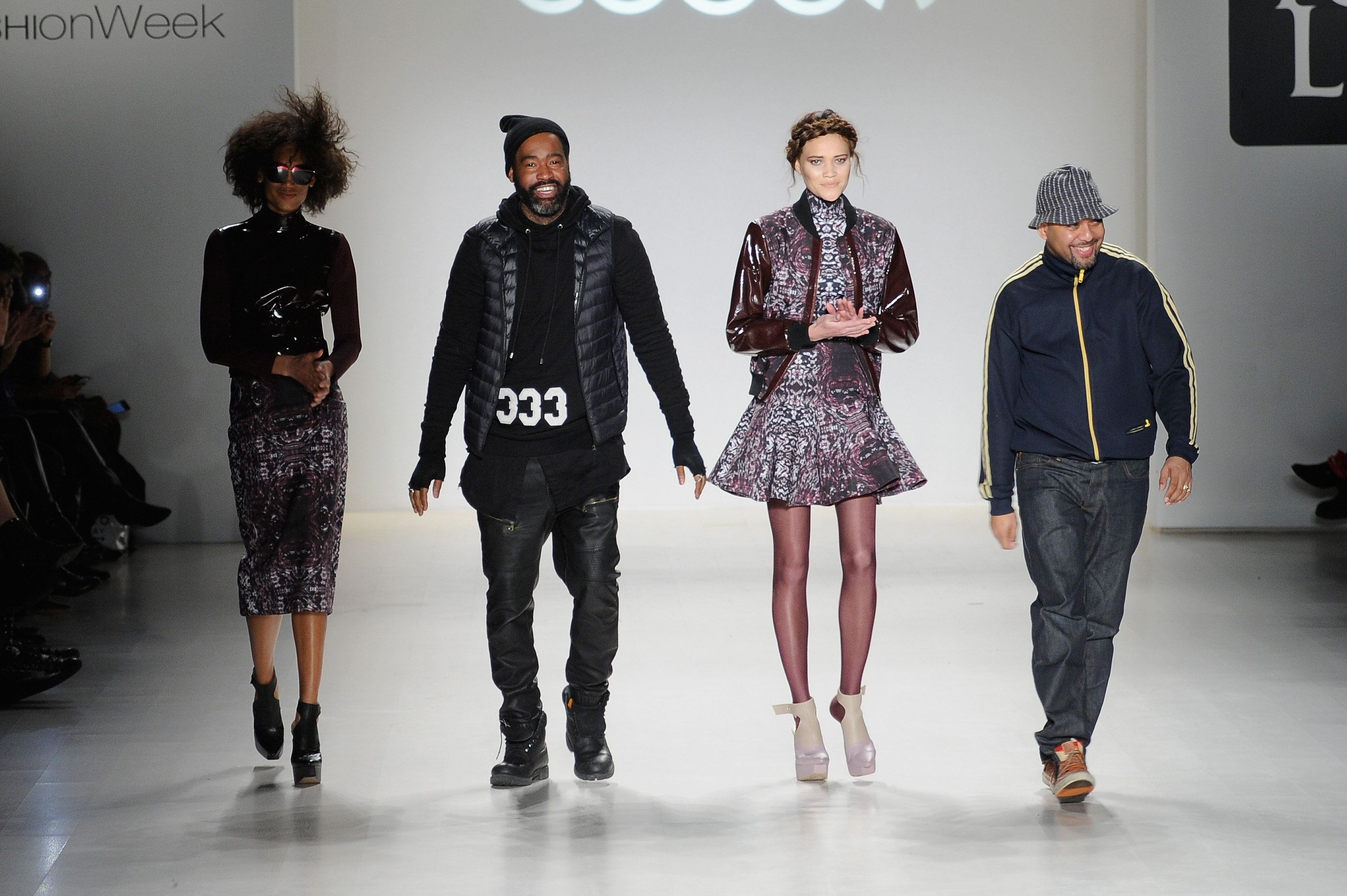 NEW YORK, NY - FEBRUARY 19:  Designer Emilio Sosa walks the runway with a model in a design by Esosa at the New York Life fashion show during Mercedes-Benz Fashion Week Fall 2015 at The Salon at Lincoln Center on February 19, 2015 in New York City.  (Photo by Arun Nevader/Getty Images for Mercedes-Benz Fashion Week Fall )