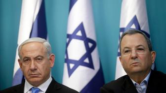 JERUSALEM, ISRAEL - NOVEMBER 21: (ISRAEL OUT) Prime Minister Benjamin Netanyahu and Defence Minister Ehud Barak look on during a press conference  on November 21, 2012 in Jerusalem, Israel.  An official ceasfire started at 9pm local time between Israel and the Palestinian Hamas movement after eight days of conflict resulting in the deaths of over 140 Palestinians, five Israelis and many hundreds injured.  (Photo by Lior Mizrahi/Getty Images)