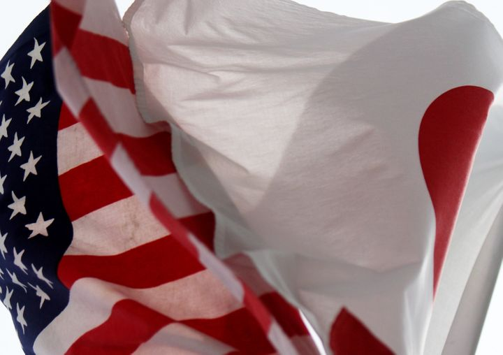 Japanese and U.S. flags fly in Tokyo, Japan.