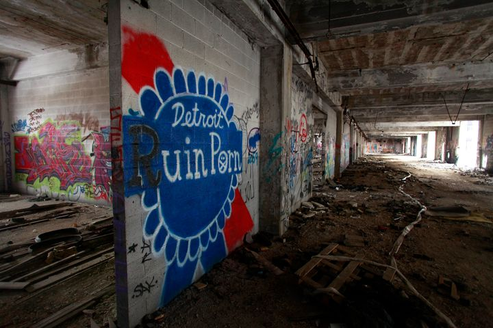 Graffiti on the walls of the Packard Plant in Detroit, December 13, 2013. (Photo by Joshua Lott/Getty Images)