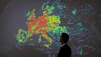 """<p>A man stands in front of a picture displaying activities of a so-called """"botnet"""" in Frankfurt am Main, Germany, on July 31, 2015.</p>"""