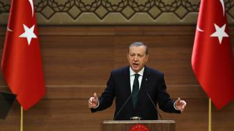 Turkish President Recep Tayyip Erdogan addresses a meeting at the presidential palace in Ankara on August 12, 2015. Erdogan vowed to fight on against Kurdistan Workers' Party (PKK) militants, in the face of mounting attacks on security forces blamed on the Kurdish rebels. AFP PHOTO/ADEM ALTAN        (Photo credit should read ADEM ALTAN/AFP/Getty Images)