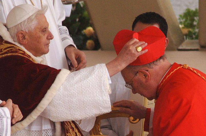 <span>New cardinal William Joseph Levada receives the biretta cap from Pope Benedict XVI in Saint Peter's Square, March 24, 2