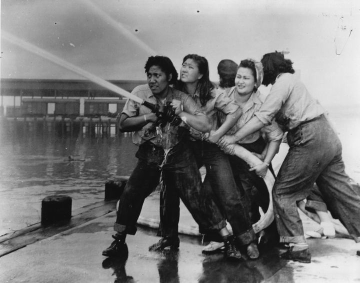 "Katherine Lowe is the second woman from the right. From Getty: ""Women fire fighters during a training exercise at the Pearl H"