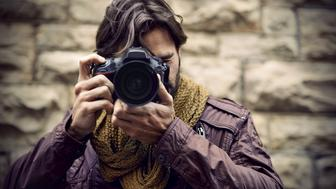 A young man taking a picture with his camera