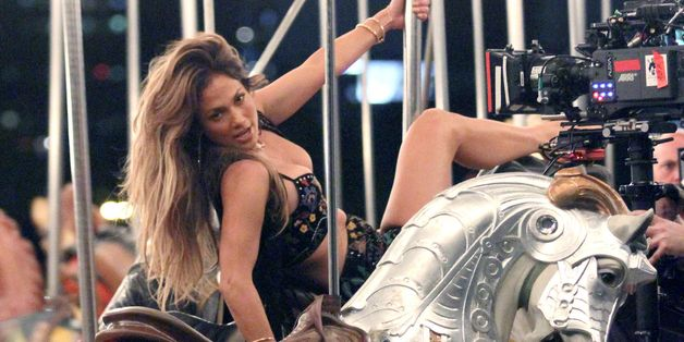 Jennifer Lopez Sizzles On Set Of New Music Video With Racy Ride On Merry-Go-Round
