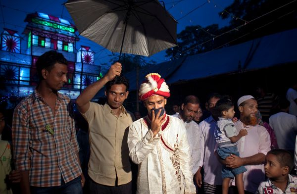32-year-old Mohammad Hasamur Rahman arrives at his wedding venue on the day that he will marry 15-year-old Nasoin Akhter