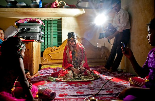 15-year-old Nasoin Akhter poses for a video on the day of her wedding to a 32-year-old man, Aug. 20, 2015 in Manikganj, Bangl