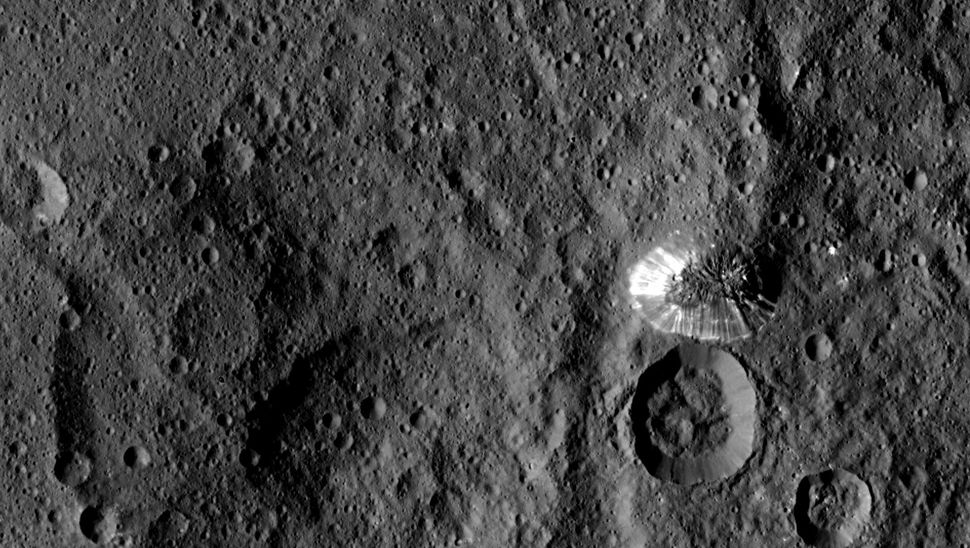 Ceres'four-mile tall mountain is seen toward the center right of this photograph, taken by NASA's Dawn spacecraft on Au