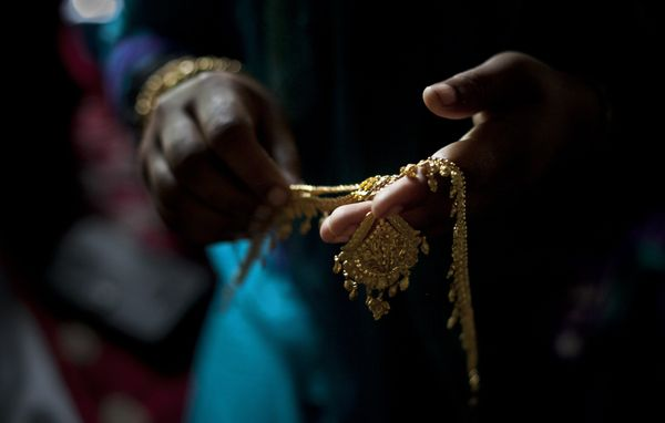 Gold wedding jewelry is laid out for 15-year-old Nasoin Akhter on the day of her wedding to a 32-year-old man, Aug. 20, 2015