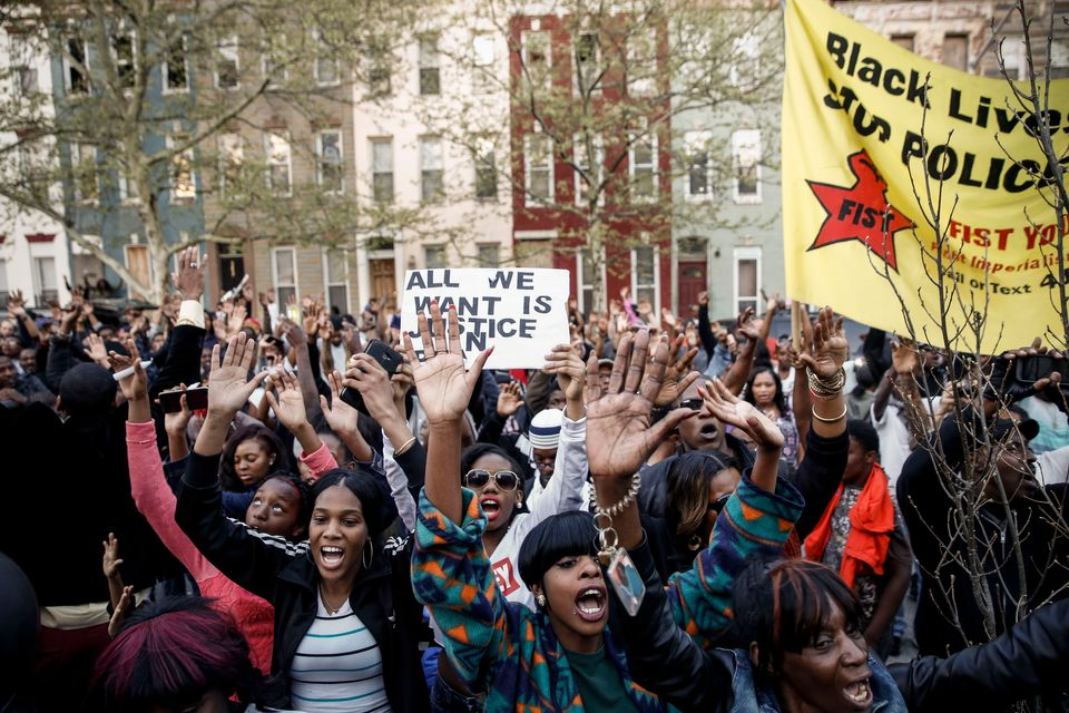 Protestors participate in a vigil for Freddie Gray down the street from the Baltimore Police Department's Western District po