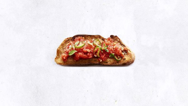 Have a few ripe tomatoes on hand? Grate them into a juicy mess, slice some spicy Serrano chilies and mound it all on thick co