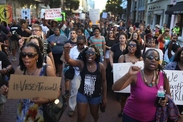 CHARLESTON, SC - JUNE 20:  A march sponsored by the Black Lives Matter movement walks through the streets to commemorate the