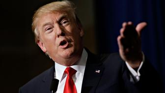 Donald Trump, president and chief executive of Trump Organization Inc. and 2016 Republican presidential candidate, speaks during a news conference ahead of a rally at Grand River Center in Dubuque, Iowa, U.S., on Tuesday, Aug. 25, 2015. President Barack Obama's top business ambassador dismissed Trump's call for a wall along the Mexico border, saying the U.S. is focused instead on expanding business with one of its biggest trade partners. Photographer: Daniel Acker/Bloomberg via Getty Images