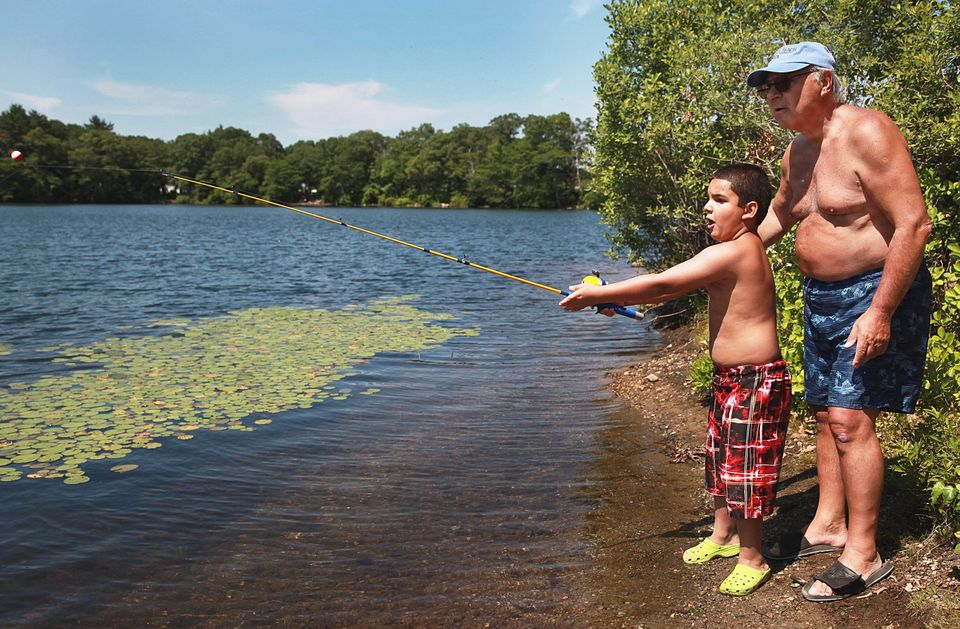 As his grandfather, Phil Bonanno, looked on, Alejandro Miro, 7, tried out his new fishing pole at Houghton's Pond in Milton,