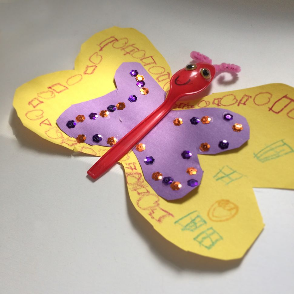 """Butterfly,"" construction paper, spoon, sequins, pipe cleaner, googly eyes"