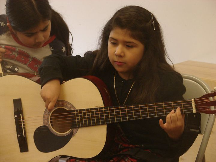 <span>Isabella Barco, 7, practices a D chord in guitar class at Christ&rsquo;s Foundry United Methodist Church in Dallas.&nbs