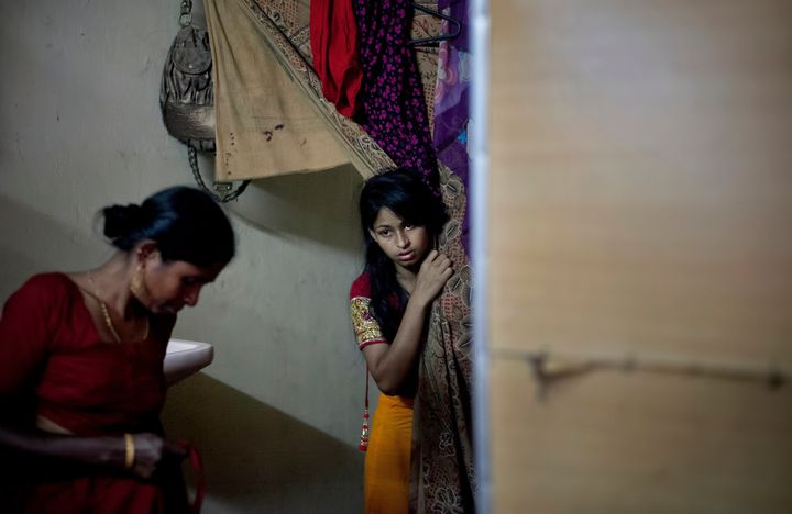 <span><span>Nasoin Akhter looks out of a dressing room at a beauty parlour on the day of her wedding.</span></span>