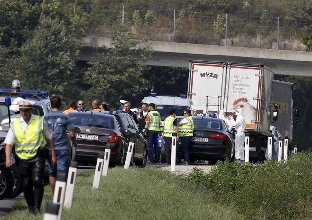 Police work around a refrigerated truck near Parndorf, Austria, on Aug. 27,