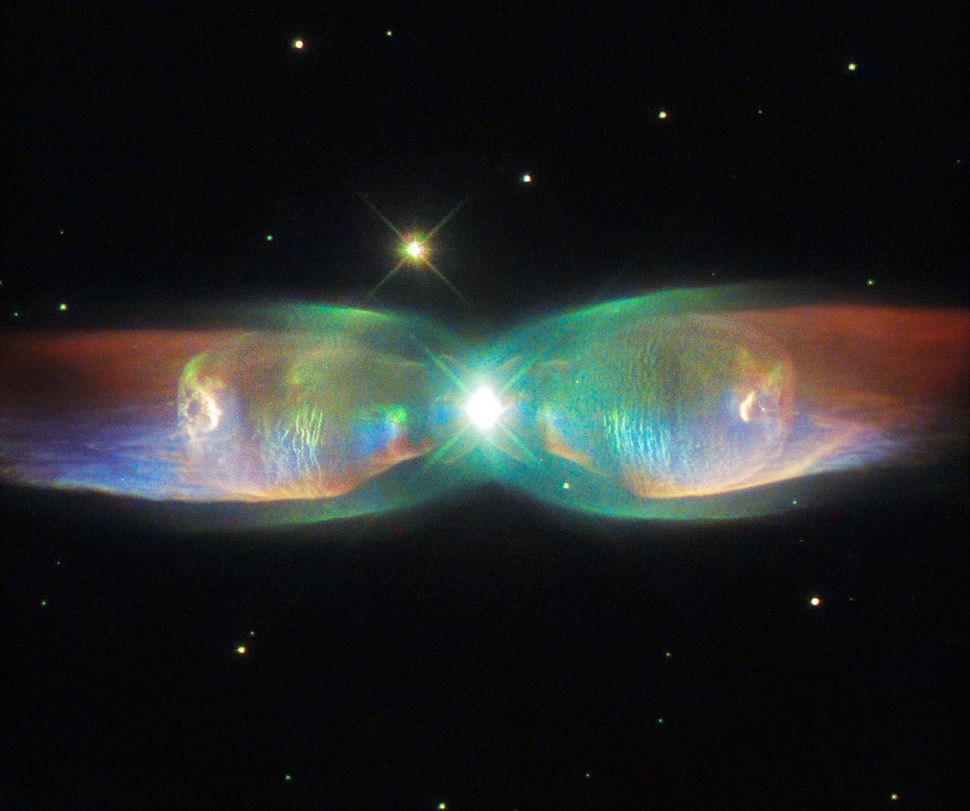 <span>The shimmering colors visible in this Hubble Space Telescope image show off the remarkable complexity of the Twin Jet N