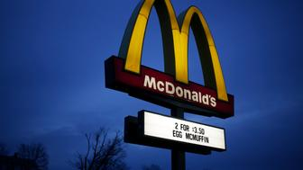 A McDonald's Corp. sign is illuminated at a restaurant in Shelbyville, Kentucky, U.S., on Friday, Jan. 23, 2015. McDonald's Corp., the world's largest restaurant chain, posted same-store sales that declined less than analysts expected as menu changes started to turn around results in the U.S. Photographer: Luke Sharrett/Bloomberg via Getty Images