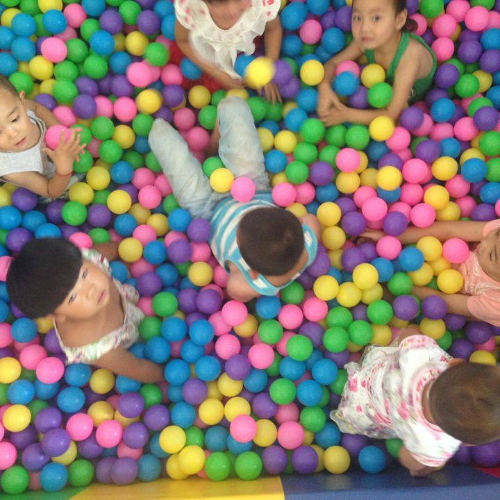 Children play at the first parenting training center opened by REAP in Danfeng County.