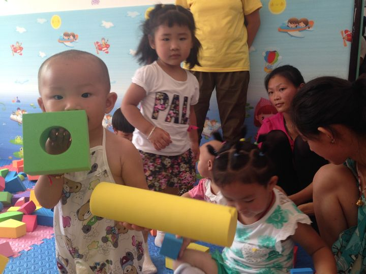 Children play at the first parenting training center REAP opened in Shaanxi Province.