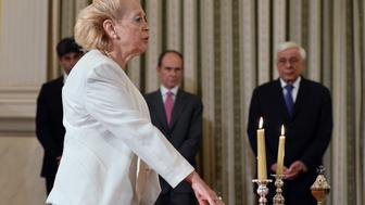 <p>Vassiliki Thanou swears in as Greke prime minister at a brief ceremony at the presidential mansion in Athens, Greece, on Aug. 27, 2015.</p>