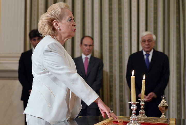 Vassiliki Thanou swears in as Greke prime minister at a brief ceremony at the presidential mansion in Athens, Greece, on Aug.