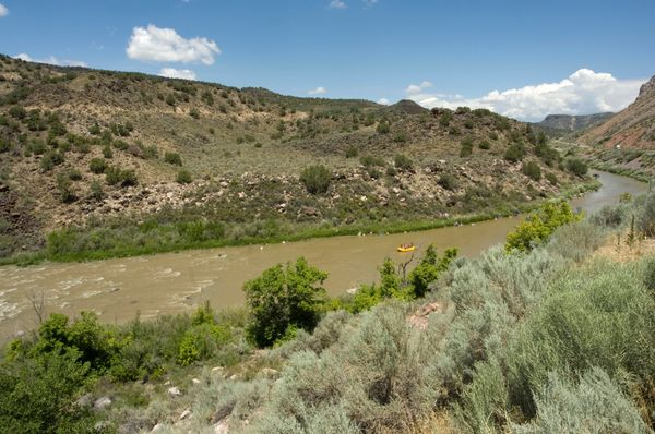 """<a href=""""http://www.newmexicoriveradventures.com/trips/view/rio-grande-gorge-full-day"""">Calm waters become rapids</a>on"""