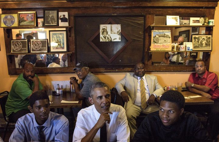 President Barack Obama waits for a lunch with residents at Willie Mae's Restaurant August 27, 2015 in New Orleans, Louisiana.