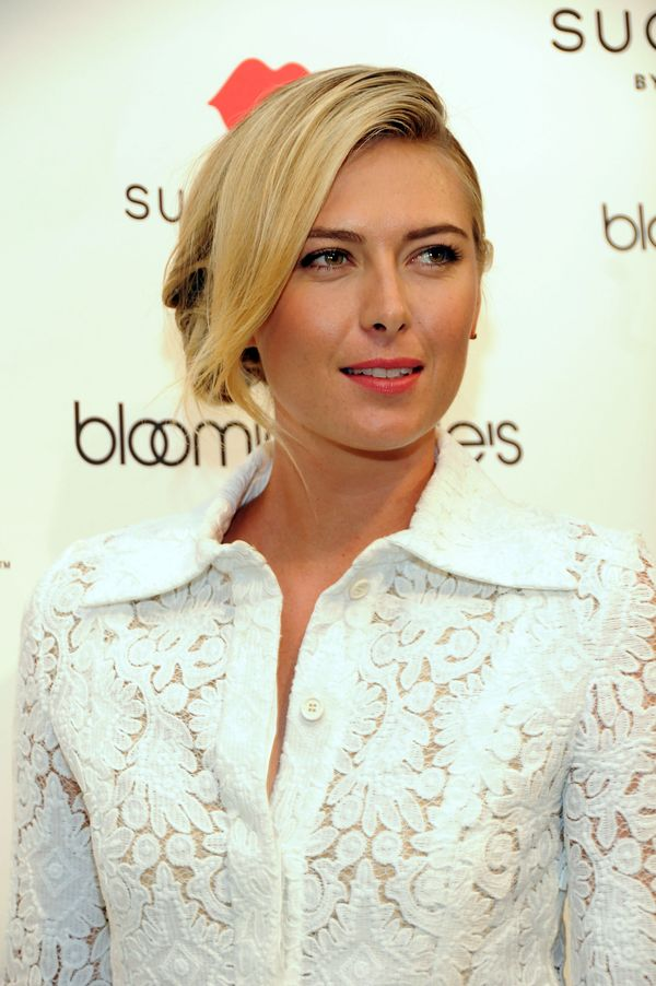 The tennis star's beauty look is more than what meets the eye. Sharapova paired her coral lipstick and swooping bangs with a